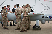 A foreign delegation listens to a briefing by a member of the British Armys Royal Artillery, demonstrating a Thales Watchkeeper UAV at the Farnborough Airshow, on 18th July 2018, in Farnborough, England.