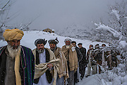 Kabul, Afghanistan - February 6, 2014: Under heavy snow weather, Afghan men, supporters of presidential candidate and former Islamist warlord Abdul Rab Rasul Sayyaf, arrive for Sayyaf's first loya jirga, or grand council of Afghan delegates, as part of his first rally campaign in Kabul. CREDIT: Photo by Mauricio Lima for The New York Times
