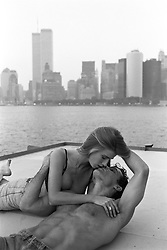 Sexy couple kissing with The World Trade Center in the background