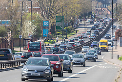 © Licensed to London News Pictures. 04/04/2021. London, UK. Long traffic jams on the A3 Roehampton Vale, South West London this afternoon as families and loved ones meet up for Easter Sunday with up to two household being able to meet in a private garden for the first time in months as Prime Minister Boris Johnson urges the public not to break the remaining Covid-19 restrictions. Photo credit: Alex Lentati/LNP