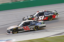 July 13, 2018 - Sparta, Kentucky, United States of America - Ty Majeski (60) and Jeremy Clements (51) battle for position during the Alsco 300 at Kentucky Speedway in Sparta, Kentucky. (Credit Image: © Chris Owens Asp Inc/ASP via ZUMA Wire)