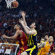Galatasaray's Preston SHUMPERT (L), Ermal KURTOGLU (R) and Fenerbahce Ulker's Darjus LAVRINOVIC (C) during their Turkish Basketball league Play Off Final fourth leg match Galatasaray between Fenerbahce Ulker at the Abdi Ipekci Arena in Istanbul Turkey on Saturday 11 June 2011. Photo by TURKPIX