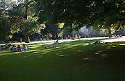 People in summer enjoying the greenery and calm of Het Park, central Rotterdam, Netherlands
