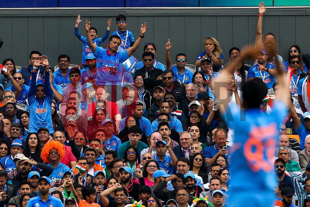 India fans react as Jasprit Bumrah of India bowls - Mandatory by-line: Robbie Stephenson/JMP - 09/07/2019 - CRICKET - Old Trafford - Manchester, England - India v New Zealand - ICC Cricket World Cup 2019 - Semi Final