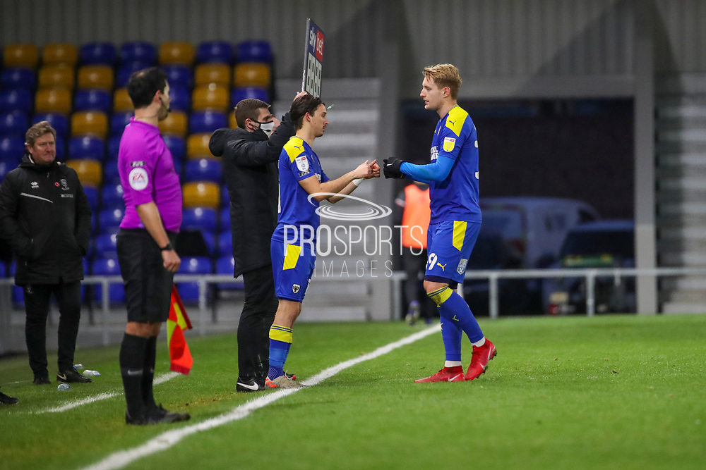 AFC Wimbledon midfielder Ethan Chislett (11) coming on for AFC Wimbledon striker Joe Pigott (39), sub during the EFL Sky Bet League 1 match between AFC Wimbledon and Lincoln City at Plough Lane, London, United Kingdom on 2 January 2021.