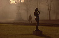 Man near Statue in Park