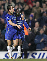 Photo: Lee Earle.<br /> Chelsea v Colchester United. The FA Cup. 19/02/2006. Chelsea's Shaun Wright Phillips (R) congratulates Joe Cole after he scored their third.