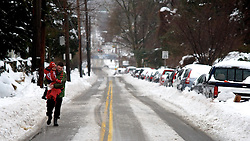View on a steep section of West Sedgwick Street. Pedestrians often choose the road over the snow covered sidewalks. (Bas Slabbers/for NewsWorks)