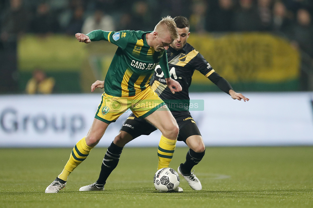 (L-R) Lex Immers of ADO Den Haag, Rai Vloet of NAC Breda during the Dutch Eredivisie match between ADO Den Haag and NAC Breda at Cars Jeans stadium on March 10, 2018 in The Hague, The Netherlands