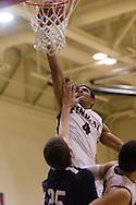 Allerik Freeman goes up and over an Impact Academy player during Findlay's nail-biting 79-78 victory.