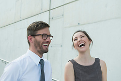 two business partners laughing