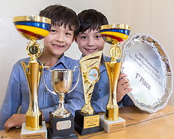 Posing with their trophies, brothers Reuben and Josh Moisey are top level Scrabble Champions with 11 year-old Reuben crowned European Youth Scrabble Champion and 8 year-old Josh became World Under Eight Scrabble Champion in Dubai in 2018. London, August 15 2019.