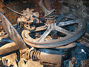 Old wheel and gear. Bill Speidel's Underground Tour beneath Pioneer Square-Skid Road Historic District, in the southwest corner of Downtown Seattle, Washington, USA.