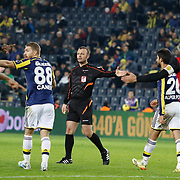 Referee's Tolga Ozkalfa (C) during their Turkish superleague soccer match Fenerbahce between Eskisehirspor at the Sukru Saracaoglu stadium in Istanbul Turkey on Saturday 30 November 2014. Photo by Kurtulus YILMAZ/TURKPIX