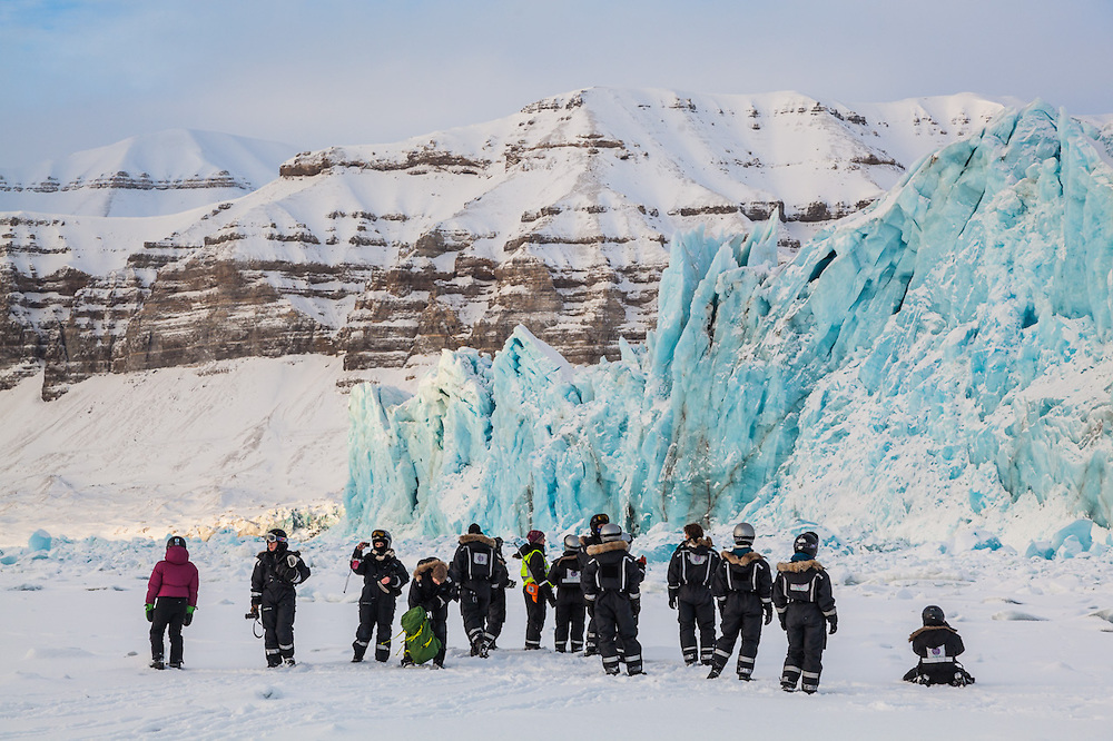UNIS students gather on sea ice in Templefjorden at the tidewater terminus of Tunabreen, Svalbard. Ultunafjella is visible across the fjord.