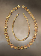 Mycenaean gold necklace from the Mycenaean cemetery of Midea tholos tomb , Dendra, Greece. National Archaeological Museum Athens.<br /> <br /> Inside mycenaean necklace has gold ivy leaf beads, Cat No 7354. The outer mycenaean necklace has rosette shaped gold beads, Cat No 7342. 15th-14th century BC. .<br /> <br /> If you prefer to buy from our ALAMY PHOTO LIBRARY  Collection visit : https://www.alamy.com/portfolio/paul-williams-funkystock/mycenaean-art-artefacts.html . Type -   Athens    - into the LOWER SEARCH WITHIN GALLERY box. Refine search by adding background colour, place, museum etc<br /> <br /> Visit our MYCENAEN ART PHOTO COLLECTIONS for more photos to download  as wall art prints https://funkystock.photoshelter.com/gallery-collection/Pictures-Images-of-Ancient-Mycenaean-Art-Artefacts-Archaeology-Sites/C0000xRC5WLQcbhQ