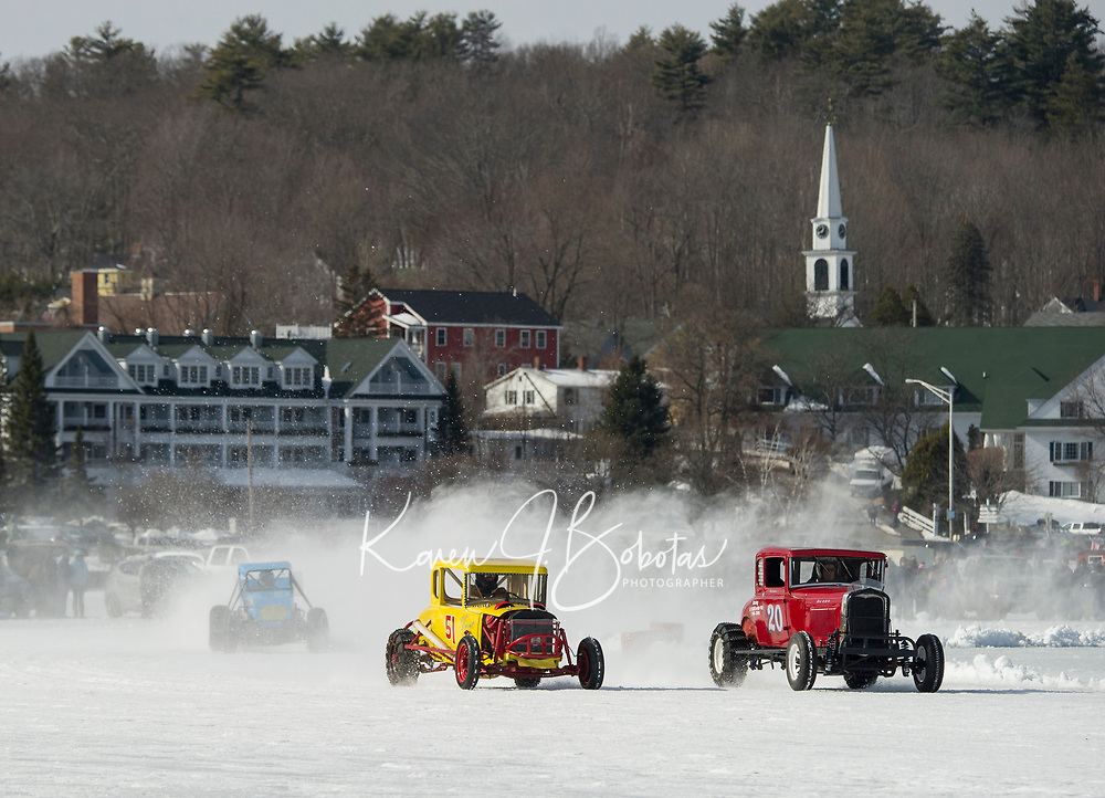 Jack Cook in #14, Nick Durand in #51 and Alan Darrah in #20 racing around the oval in the Vintage class Sunday afternoon during the Nostalgic Latchkey Cup on Meredith Bay.  (Karen Bobotas/for the Laconia Daily Sun)