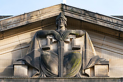 Detail of stone decorative relief on the High Court of Justiciary on the Royal Mile in Edinburgh, Scotland, UK