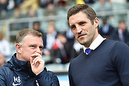 Coventry City manager Mark Robins  chats to Shrewsbury Town manager Sam Ricketts  during the EFL Sky Bet League 1 match between Coventry City and Shrewsbury Town at the Ricoh Arena, Coventry, England on 28 April 2019.