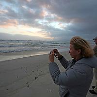 "South Africa, Cape Overberg, Walker Bay. Land-based whale watching at Walker Bay Beach ""Die Plaat"" near Stanford on the Hermanus Lagoon."