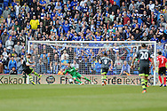 Stoke city's Marko Arnautovic (10) scores his sides 1st goal from a penalty as the Cardiff fans behind goal attempt to put him off. Barclays Premier league match, Cardiff city  v Stoke city at the Cardiff city stadium in Cardiff, South Wales on Saturday 19th April 2014. pic by Andrew Orchard, Andrew Orchard sports photography,