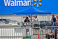 COVID-19 testing site in LaPlace Louisiana in the parking  lot of a Walmart Superstore.