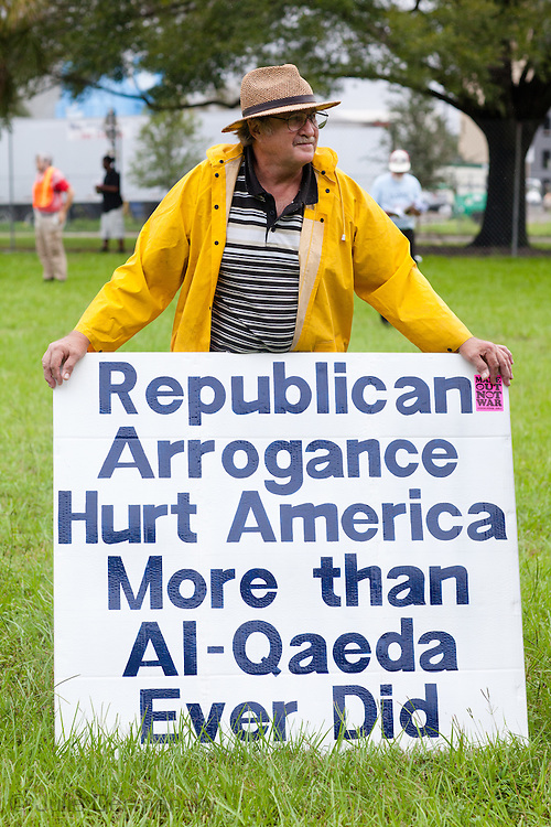 August 27th, 2012, Tampa Florida, protester  with an anti-Republican sign in Harvey Park  with the Coalition to March on the Republican National Convention before rally begins.