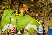 New York, NY – 27 November 2019. Thousands of spectators packed the streets around the American Museum of Natural History to see the inflation area for the balloons for Macy's Thanksgiving Day Parade.  The Green Eggs and Ham balloon, after the book by Dr. Seuss, was a popular attraction.