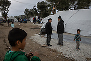 Two elderly men are seen talking in the camp. About 20000 are living in a makeshift camp nearby the city of Moria on the island of Lesbos in miserable conditions, most of the without water, electricity nor sanitary facilities.  Federico Scoppa
