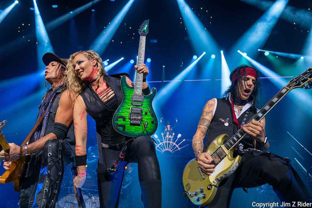 Guitarist RYAN ROXIE, left, NITA STRAUSS, guitar and vocals, and TOMMY HENRIKSEN, rhythm and lead guitar, perform with Alice Cooper.  After nearly 19 months off stage, Rock and Roll legend Alice Cooper, 73, launches his fall 2021 tour at Ocean Casino Resort in Atlantic City, New Jersey.