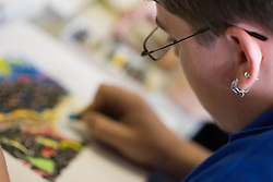 Close up of student working with pastels in Art class,
