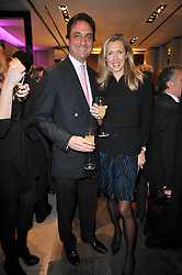 COUNT & COUNTESS ALLESANDRO GUERRINI-MARALDI at a party to launch the book 'Italian Touch' - A Celebration of Italian Lifestyle held at TOD's, 2-5 Old Bond Street, London on 4th November 2009.