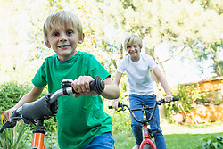 Two brothers with her bikes in the garden
