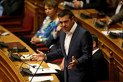 June 14, 2018 - Athens, Greece - Greek Prime Minister Alexis Tsipras speaks at a parliamentary session, in Athens, Greece. Greece's government passed on Thursday the last set of measures requested by international lenders to conclude the final review of the third Greek bailout program since 2010. However, it faced a no-confidence motion on the Macedonia name issue agreement reached earlier this week. (Credit Image: © Marios Lolos/Xinhua via ZUMA Wire)