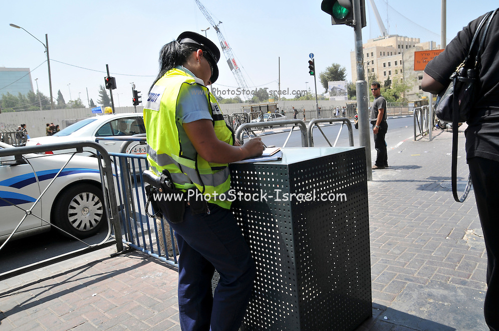 Israel, Jerusalem, Policewoman on duty at the entrance to the central bus station