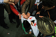 Pro-Assad demonstrators shout slogans and burn the pre-Ba'ath party Syrian flag, now a symbol of the resistance, at a rally outside the Istanbul Congress Centre, where the Second Conference of the Group of Friends of the Syrian People was being held, Istanbul, April 1st 2012. Bradley Secker / ENN