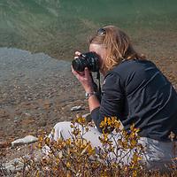 Photographers frame scenes beside Bow Lake in Banff National Park, Alberta, Canada.