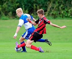 Bristol Rovers' U18s Ryan Broom is tackled - Photo mandatory by-line: Dougie Allward/JMP - Tel: Mobile: 07966 386802 17/08/2013 - SPORT - FOOTBALL - Bristol Rovers Training Ground - Friends Life Sports Ground - Bristol - Academy - Under 18s - Youth - Bristol Rovers U18s V Bournemouth U18s