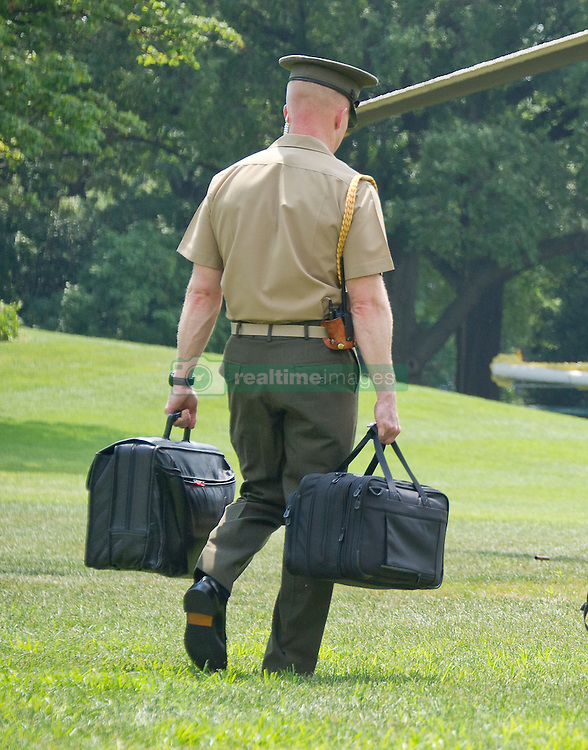 A United States Marine carries the bags containing the nuclear codes as US President Barack Obama and members of the first family departs the White House in Washington, DC, USA, on Saturday, August 6, 2016 to travel to Martha's Vineyard, Massachusetts for their annual two week vacation. Photo by Ron Sachs/Pool/ABACAPRESS.COM