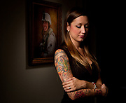 Rachel Smith stands next to a portrait of her husband Marine Staff Sgt. Jeremy Smith, 26, at her home in Fort Worth, Texas, Wednesday September 28, 2011. Staff Sgt. Jeremy Smith was killed in a friendly fire incident in Afghanistan in April 2011. This weekend his battalion is returning to Houston without him. His widow, Rachel Smith, plans to meet his fellow Marines at Ellington International Airport when they reunite with their families. In memory of her husband Rachel Smith has a series of tattoos on her right arm honoring him as a Marine and her life's love. ( Billy Smith II \ Houston Chronicle)