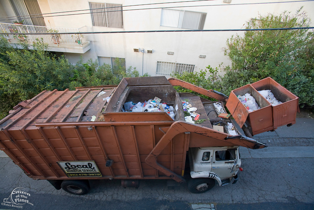 Garbage Truck picks up dumpsters of non-recyclable trash in West LA alley, In 2008 Los Angeles launched SWIRP (Solid Waste Integrated Resources Plan) which will include pick up of recyclable refuse from multi-family units, California, USA
