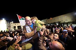 60875568<br /> Palestinian relatives of the newly released prisoners celebrate upon their arrival in the West Bank city of Ramallah, on Dec. 31, 2013. Israel freed 26 Palestinian prisoners early Tuesday, as part of a U.S.-brokered agreement to resume direct peace talks between the two sides, Tuesday, 31st December 2013. Picture by  imago / i-Images<br /> UK ONLY