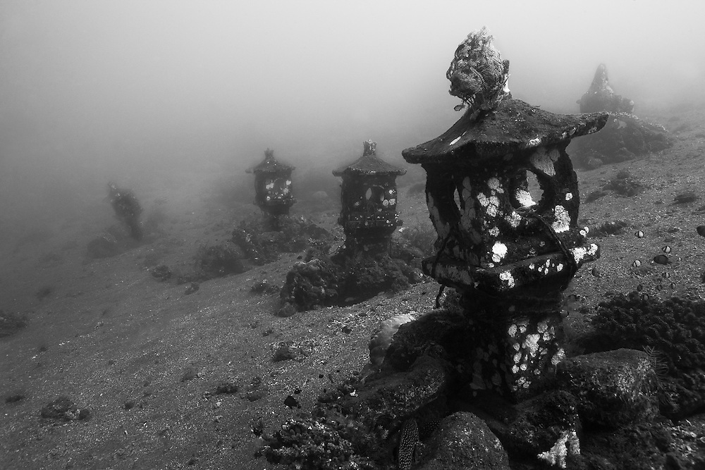 INDONESIA. Tulamben, Bali. June 19. 2013. Small stupas sunken along a volcanic slope.  They are part of a small Balinese style shrine that was sunk to become an artificial reef.