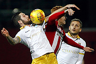 Jacob Butterfield of Sheffield Wednesday (L) battles in the air with Ryan Woods of Brentford (R). EFL Skybet football league championship match, Brentford v Sheffield Wednesday at Griffin Park in London on Saturday 30th December 2017.<br /> pic by Steffan Bowen, Andrew Orchard sports photography.