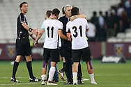 Marius Sumudica, manager of Astra Giurgiu kisses Constantin Florea of Astra Giurgiu and Alexandru Ionița of Astra Giurgiu after full time.UEFA Europa league, 1st play off round match, 2nd leg, West Ham Utd v Astra Giurgiu at the London Stadium, Queen Elizabeth Olympic Park in London on Thursday 25th August 2016.<br /> pic by John Patrick Fletcher, Andrew Orchard sports photography.