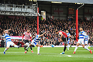 Brentford Forward Oliver Watkins (11) takes a shot on goal during the EFL Sky Bet Championship match between Brentford and Queens Park Rangers at Griffin Park, London, England on 2 March 2019.