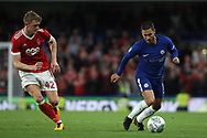 Eden Hazard of Chelsea (R) takes on Joe Worrall of Nottingham Forest (L). Carabao Cup 3rd round match, Chelsea v Nottingham Forest at Stamford Bridge in London on Wednesday 20th September 2017.<br /> pic by Steffan Bowen, Andrew Orchard sports photography.