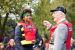 © Licensed to London News Pictures. 11/10/2015. Southwick, UK. Radzi Chinyanganya of Blue Peter at The 2015 Conker World Championships celebrates it's 50th year with competitors from around the world competing to become this years conker king. Photo credit: Andrew McCaren/LNP