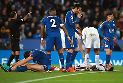 """Burnley's Robbie Brady (bottom right) lies injured after clashing into Leicester City's Harry Maguire (bottom left) during the Premier League match at the King Power Stadium, Leicester. PRESS ASSOCIATION Photo Picture date: Saturday December 2, 2017. See PA story SOCCER Leicester. Photo credit should read: Mike Egerton/PA Wire. RESTRICTIONS: EDITORIAL USE ONLY No use with unauthorised audio, video, data, fixture lists, club/league logos or """"live"""" services. Online in-match use limited to 75 images, no video emulation. No use in betting, games or single club/league/player publications."""