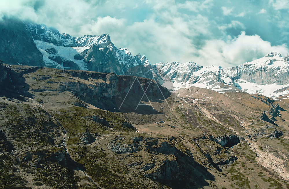 Aerial view of part of the Matterhorn Mountain range with a sight of some beautiful peaks and icy ravines in Cervinia, Aosta Valley, Italy.